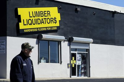 Lumber Liquidators Can't Chop Down OT Collective Action - Law360