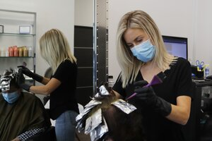 A Virginia federal judge found that a virus exclusion in a hair salon's insurance policy with aHartford unit barred coverage. (AP Photo/Carlos Osorio)
